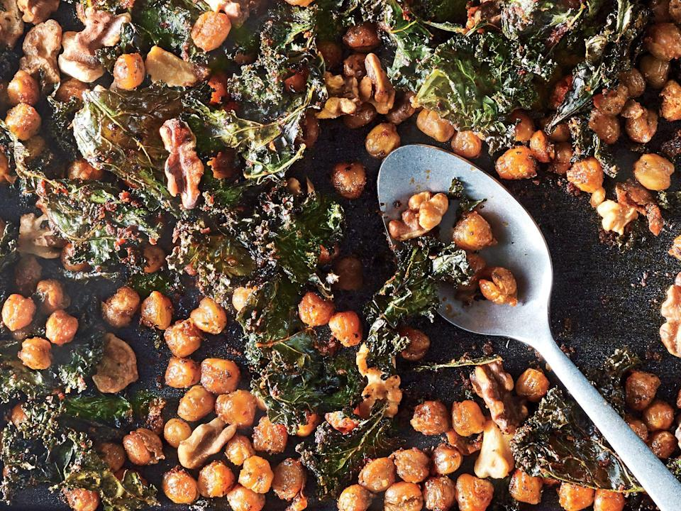 """<p>This fiber-filled, gluten-free snack mix is great sprinkled over salads to give them a little spicy crunch.</p> <p><a href=""""https://www.myrecipes.com/recipe/roasted-chickpea-snack-mix"""" rel=""""nofollow noopener"""" target=""""_blank"""" data-ylk=""""slk:Roasted Kale and Chickpea Snack Mix Recipe"""" class=""""link rapid-noclick-resp"""">Roasted Kale and Chickpea Snack Mix Recipe</a></p>"""