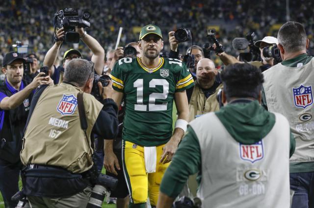 Aaron Rodgers walks off the field after leading a comeback victory over the Chicago Bears in Week 1. (AP Photo)