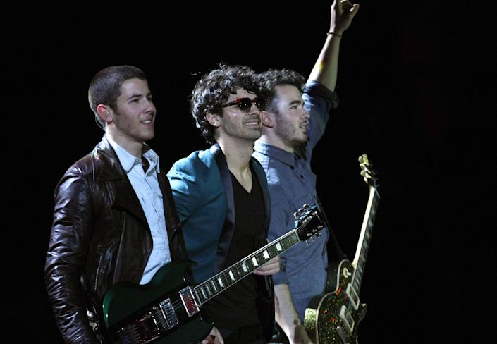 The Jonas Brothers, from left to right Nick, Joe and Kevin, perform at the Vina del Mar International Song Festival in Vina del Mar, Chile, Tuesday, Feb. 26, 2013. Believed to be one of the largest musical events in Latin America, the annual 5-day festival was inaugurated in 1960. (AP Photo/Luis Hidalgo)