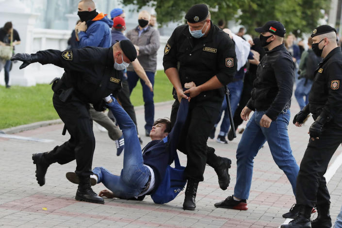 FILE In this file photo taken on Tuesday, July 14, 2020, Police officers detain a protester during a rally against the removal of opposition candidates from the presidential elections in Minsk, Belarus. Belarus' authoritarian President Alexander Lukashenko faces a perfect storm as he seeks a sixth term in the election held Sunday, Aug. 9, 2020 after 26 years in office. Mounting public discontent over the worsening economy and his government's bungled handling of the coronavirus pandemic has fueled the largest opposition rallies since the Soviet collapse. (AP Photo/Sergei Grits, File)
