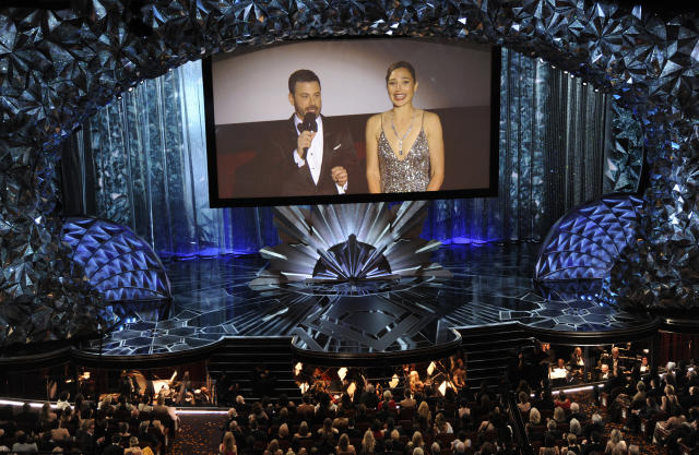 Jimmy Kimmel and Gal Gadot appear on screen via satellite after highjacking a nearby movie theater. (Photo by Chris Pizzello/Invision/AP)