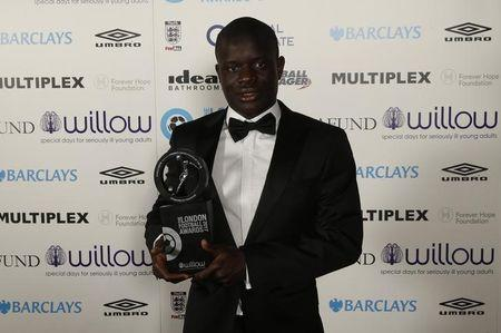 Britain Football Soccer - London Football Awards 2017 - Battersea Evolution - 2/3/17 Chelsea's N'Golo Kante poses with the Premier League player of the year award during the London Football Awards 2017  Action Images via Reuters / Matthew Childs Livepic/File Photo