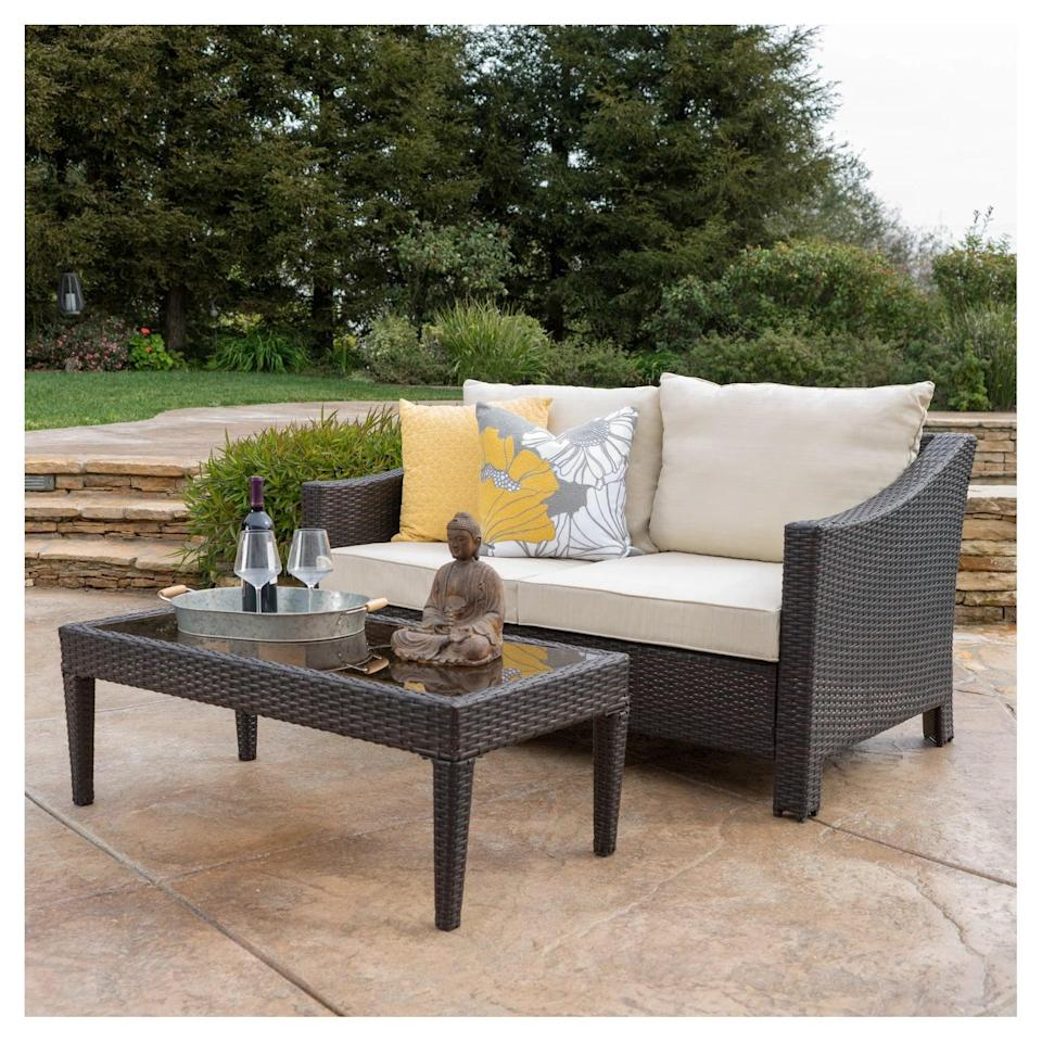 <p>You'll never want to go inside with this <span>Antibes Wicker Loveseat and Table</span> ($500) on your patio.</p>