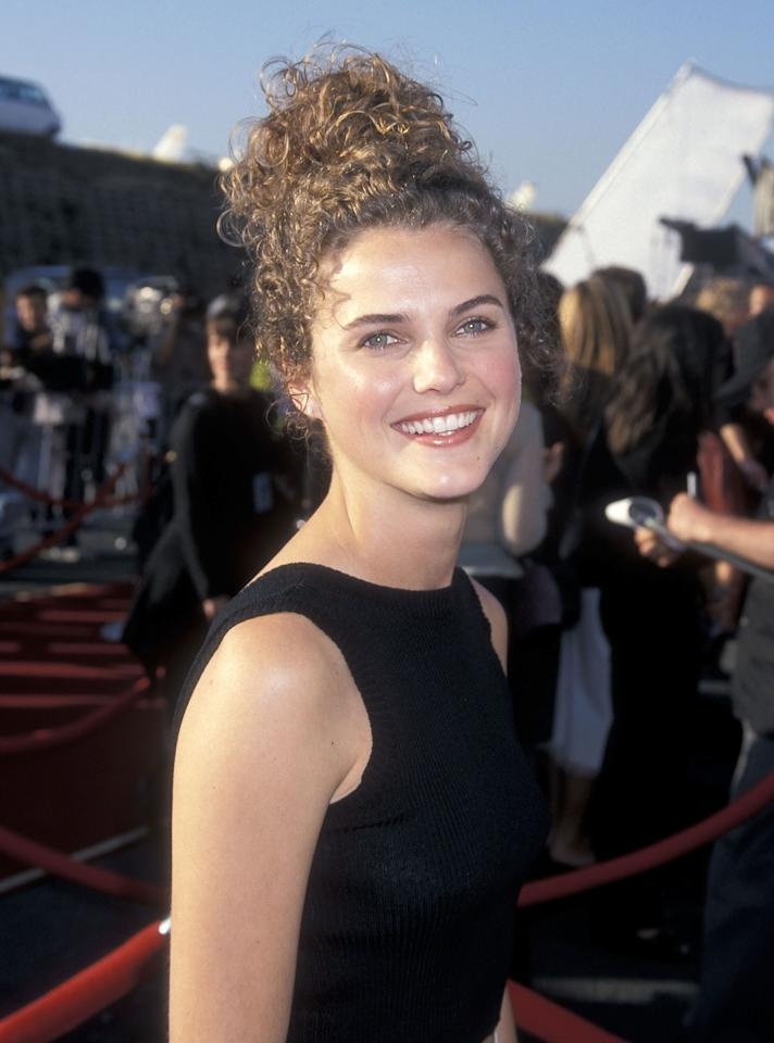 <p>At the Eighth Annual MTV Movie Awards in 1999, Russell arrives fresh faced with her hair in a messy top knot.</p>