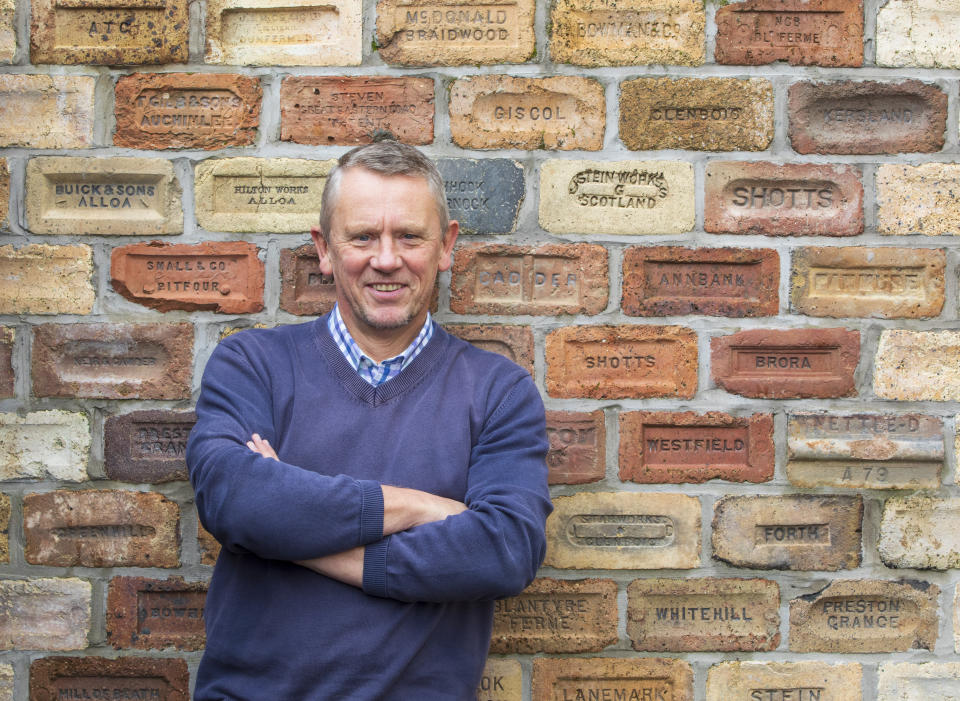 Brick by brick: Proud Mark Cranston with part of his huge collection. (SWNS)