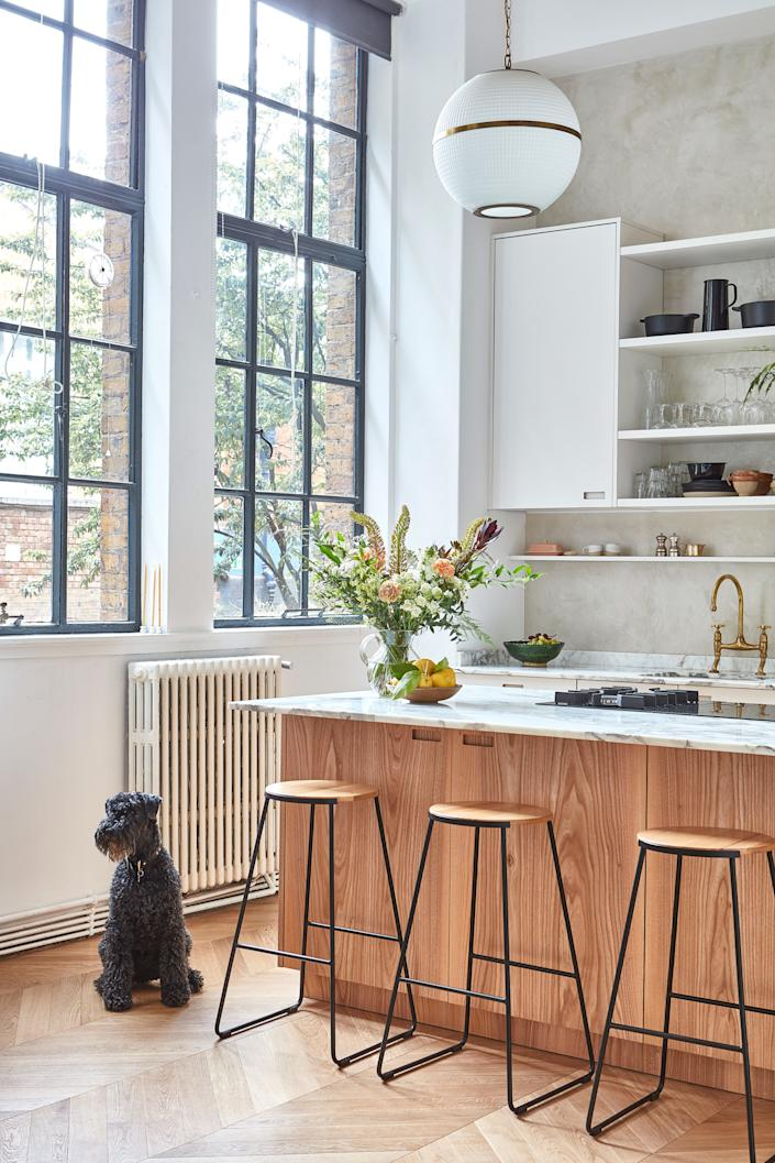"""<div class=""""caption""""> """"I love the elm used for the island,"""" says Anna. """"The larder cupboard is definitely a favorite feature. I have everything in jars, so it's always very pleasing to look at—and to use."""" </div>"""