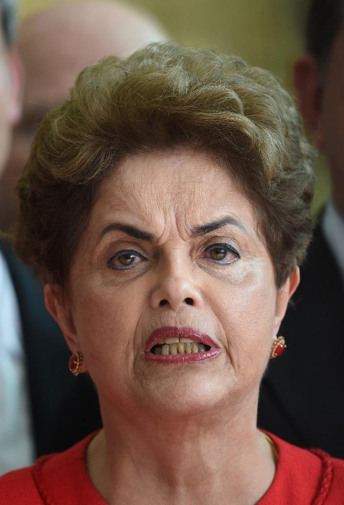 Brazil's Dilma Rousseff pled her innocence during a marathon 14-hour session, saying abuse of the impeachment process put the country's democracy at risk (AFP Photo/Evaristo Sa)