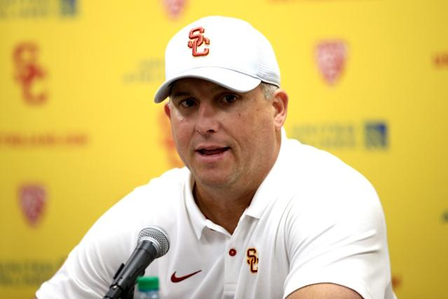 """USC football coach Clay Helton, shown in November, suggested Friday that his team would probably need a """"minimum of four weeks"""" of ramp-up before safely proceeding with camp in the fall. <span class=""""copyright"""">(Sean M. Haffey / Getty Images)</span>"""