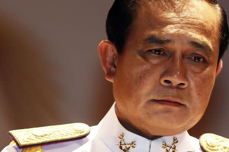 File photo of Thai Army chief General Prayuth Chan-ocha pausing as he addresses reporters at the Royal Thai Army Headquarters in Bangkok