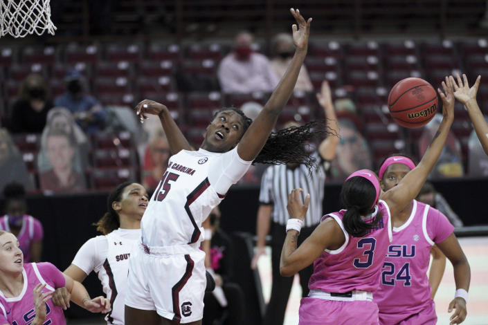 South Carolina forward Laeticia Amihere (15) battles for a rebound against LSU guard Khayla Pointer (3) during the first half of an NCAA college basketball game Sunday, Feb. 14, 2021, in Columbia, S.C. (AP Photo/Sean Rayford)