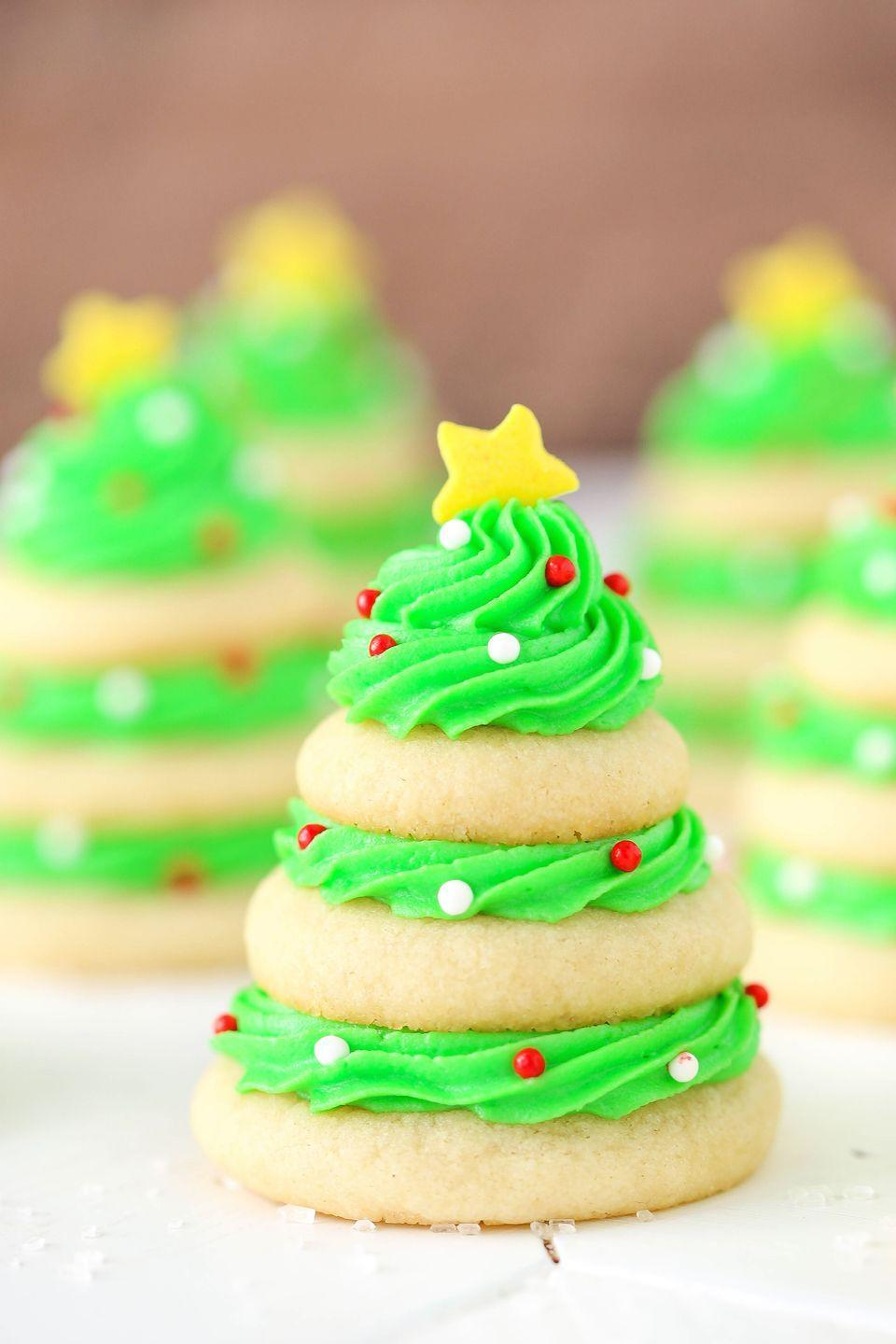 "<p>Ask yourself, would you rather decorate a real tree, or a sugar cookie Christmas tree?</p><p>Get the recipe from <a href=""https://www.delish.com/cooking/recipe-ideas/recipes/a50445/christmas-tree-cookie-stacks/"" rel=""nofollow noopener"" target=""_blank"" data-ylk=""slk:Delish"" class=""link rapid-noclick-resp"">Delish</a>.</p>"