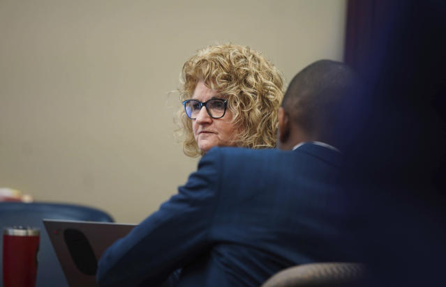 Former Michigan State University women's gymnastics coach Kathie Klages listens to prosecutor's opening statements Tuesday in Ingham County Circuit Court. (AP)