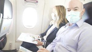 Sunwing's acting Chief Medical Advisor, Dr. Nord, on board a Sunwing Airlines flight to Cancun.