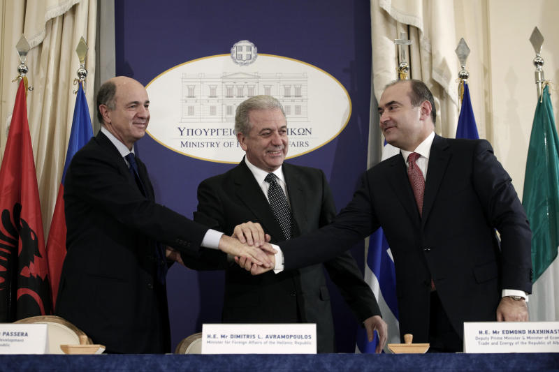 Greek Foreign Minister Dimitris Avramopoulos, center, Albanian Finance and Energy Minister Edmond Haxhinasto, right, and Italian Development Minister Corrado Passera shake hands during a signing ceremony backing the privately-funded venture known as the Trans-Adriatic Pipeline, worth euro 1.5 billion ($2.02 billion), in Athens, on Wednesday, Feb. 13, 2013. Greece, Italy and Albania signed an agreement backing a proposed pipeline to transport natural gas from the Caspian Sea to western Europe. (AP Photo/Petros Giannakouris)