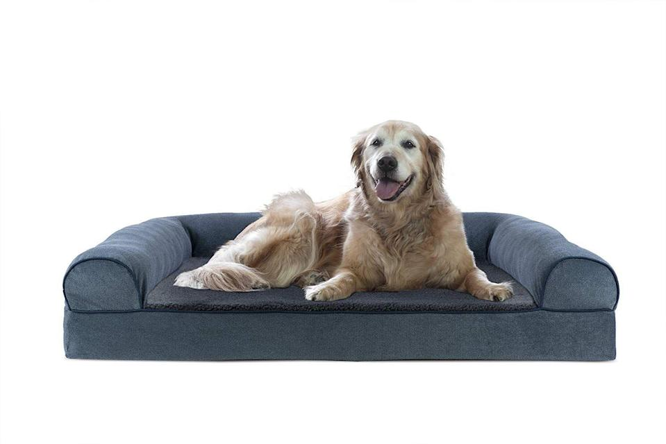 """<h3>Supportive Memory Foam Pet Sofa</h3><p>This Amazon-Choice pet sofa comes highly recommended for elderly or disabled fur friends because of its supportive and temperature-regulating memory foam interior with super-plush fleece and chenille cover.</p><br><br><strong>Furhaven Pet</strong> Sofa-Style Memory Foam Pet Bed, $51.99, available at <a href=""""https://www.amazon.com/Furhaven-Pet-Orthopedic-Chenille-Sofa-Style/dp/B074F25LTC/ref=sr_1_5"""" rel=""""nofollow noopener"""" target=""""_blank"""" data-ylk=""""slk:Amazon"""" class=""""link rapid-noclick-resp"""">Amazon</a>"""