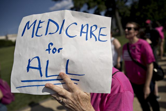 A demonstrator opposed to the Senate Republican health care plan holds a sign while marching near the Capitol on June 28, 2017. (Photo: Andrew Harrer/Bloomberg via Getty Images)