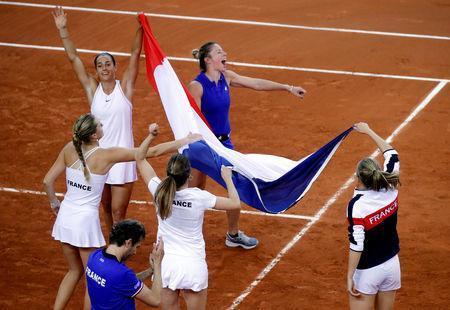 Tennis - Fed Cup - World Group Semi-Final - France v Romania - Kindarena, Rouen, France - April 21, 2019 France celebrate victory in the semi-final REUTERS/Charles Platiau