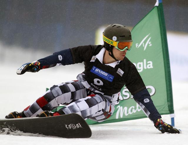 Vic Wild of Russaia speeds down the course to place fifth during the men's parallel slalom race at the Snowboard World Cup event in Rogla, Slovenia, on Saturday, Jan. 18. 2014. Tim Mathies won the race in front of second placed Zan Kosir of Slovenia and third Sylvian Dufour of France. (AP Photo/Filip Horvat)