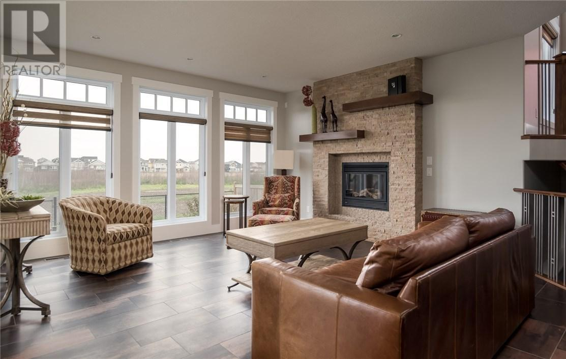 """<p><a rel=""""nofollow"""">209 Trillium Rd., Fort McMurray, Alta.</a><br /> This 2,698-square-foot home is custom built and sits on a greenbelt.<br /> (Photo: Zoocasa) </p>"""