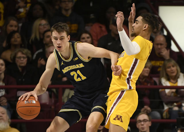 Minnesota's Tre' Williams, right, guards against Michigan's Franz Wagner (21) in the first half during an NCAA college basketball game on Sunday, Jan. 12, 2020, in Minneapolis. (AP Photo/Hannah Foslien)