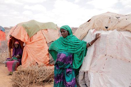 A nine-month pregnant displaced woman, Amina Ali, 23, stands beside her shelter at a makeshift settlement in Bardihahle near Burao, northwestern Togdheer region of Somaliland March 26, 2017.  REUTERS/Zohra Bensemra