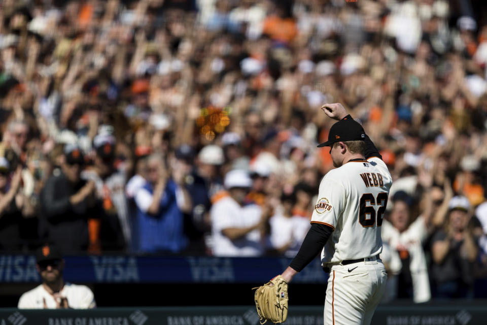 San Francisco Giants starting pitcher Logan Webb acknowledges the fans as he leaves the field in the eighth inning of a baseball game against the San Diego Padres in San Francisco, Sunday, Oct. 3, 2021. (AP Photo/John Hefti)