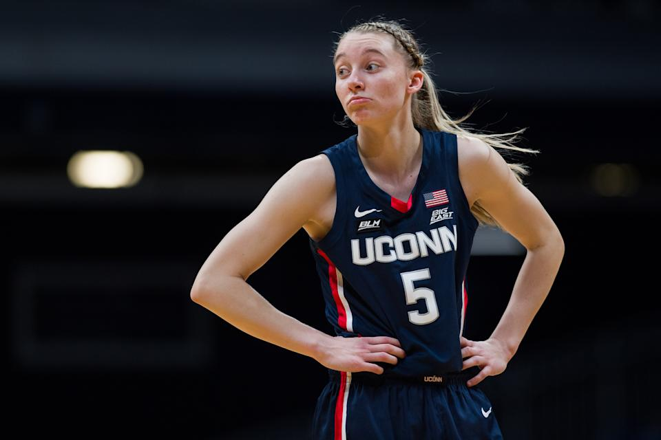 INDIANAPOLIS, IN - FEBRUARY 27: UConn Huskies guard Paige Bueckers (5) responds to a call during the women's basketball game between the Butler Bulldogs and UConn Huskies on February 27, 2021 at Hinkle Fieldhouse in Indianapolis, IN.  (Photo by Zach Bolinger / Icon Sportswire via Getty Images)