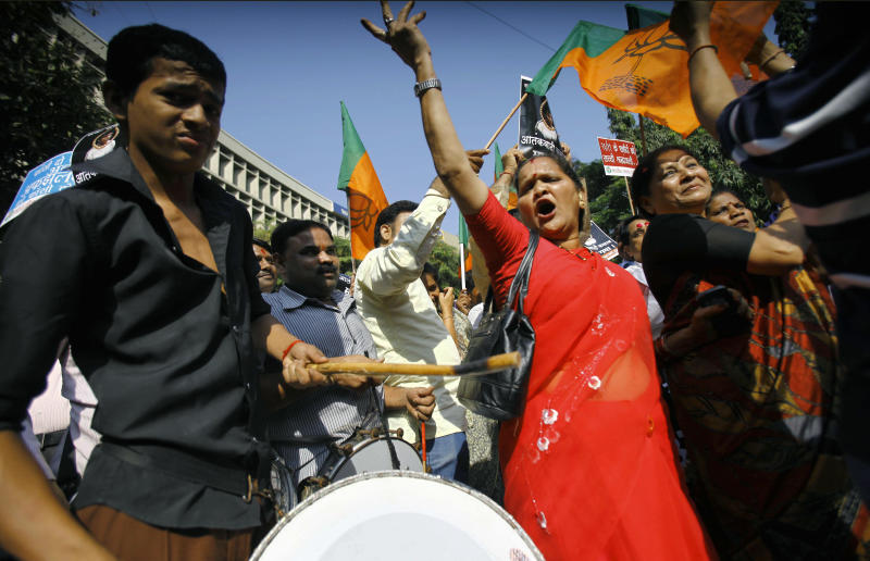 Activists of India's main opposition Bharatiya Janata Party (BJP) dance to celebrate the news of Mohammed Ajmal Kasab's execution, in Mumbai, India, Wednesday, Nov. 21, 2012. India executed Kasab, the lone surviving gunman from the 2008 Mumbai terror attack early Wednesday, four years after Pakistani gunmen blazed through India's financial capital, killing 166 people and throwing relations between the nuclear-armed neighbors into a tailspin. (AP Photo/Rafiq Maqbool)