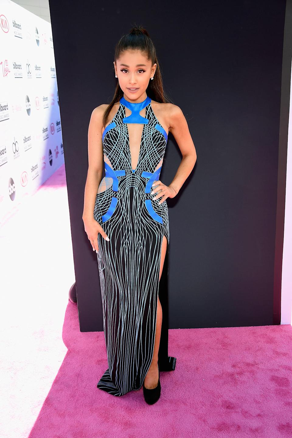 The <em>very</em> high slit of this gown by Atelier Versace is both daring and makes for a futuristic spin on the cocktail dress.