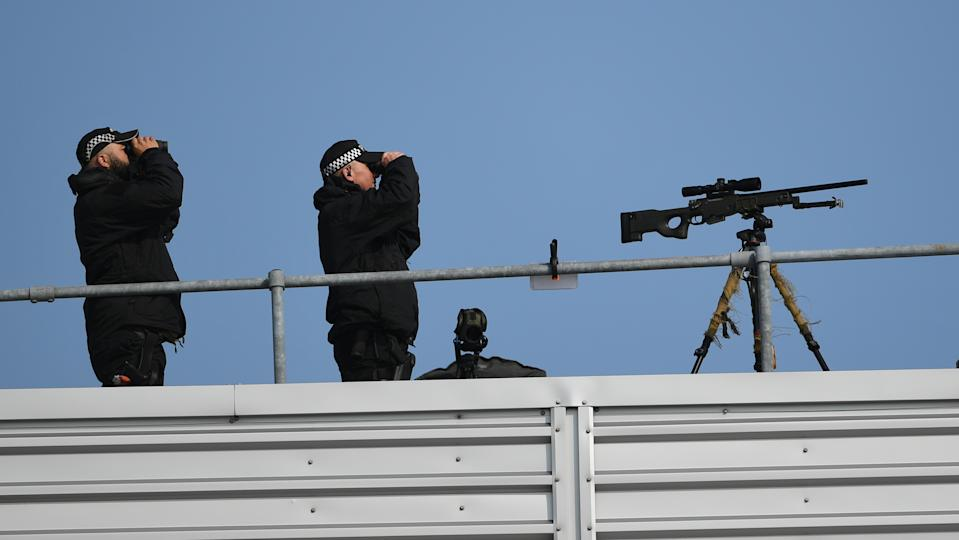 Eagle-eyed: Security around Stansted Airport was incredibly tight ahead of the President touching down in the UK, with armed police manning roofs overlooking the airspace. (PA)