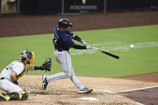 Seattle Mariners' Luis Torrens hits an RBI double during the third inning of the team's baseball game against the San Diego Padres on Saturday, Sept. 19, 2020, in San Diego. (AP Photo/Denis Poroy)