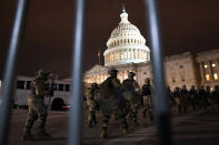 Members of the National Guard arrive to secure the area outside the U.S. Capitol, Wednesday, Jan. 6, 2021, in Washington. (AP Photo/Jacquelyn Martin)