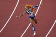 Sha'Carri Richardson celebrates after winning the women's 100-meter run at the U.S. Olympic Track and Field Trials Saturday, June 19, 2021, in Eugene, Ore.(AP Photo/Charlie Riedel)