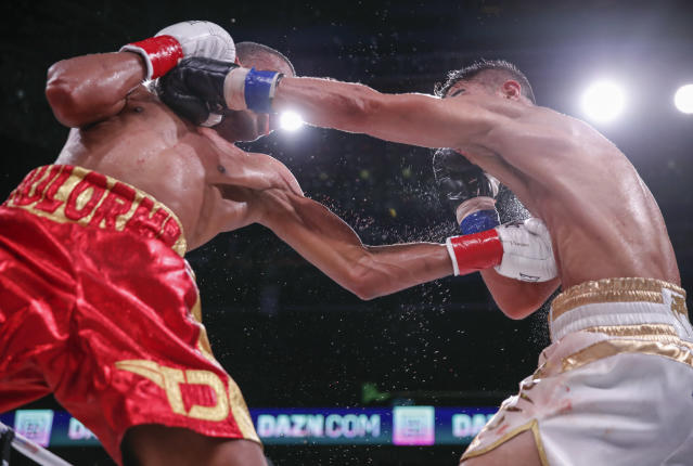 Thomas Dulorme, left, trades punches with Jessie Vargas during a boxing bout Saturday, Oct. 6, 2018, in Chicago. (AP Photo/Kamil Krzaczynski)