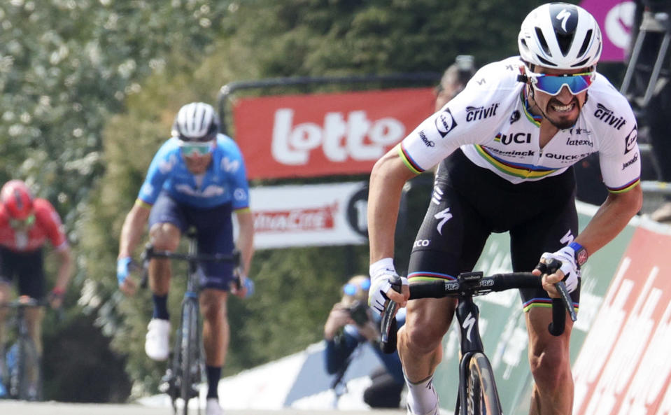 France's Julian Alaphilippe of the Deceuninck Quick-Step team sprints to the finish line to win the Belgian cycling classic and UCI World Tour race Fleche Wallonne, in Huy, Belgium, Wednesday, April 21, 2021. (AP Photo/Olivier Matthys)
