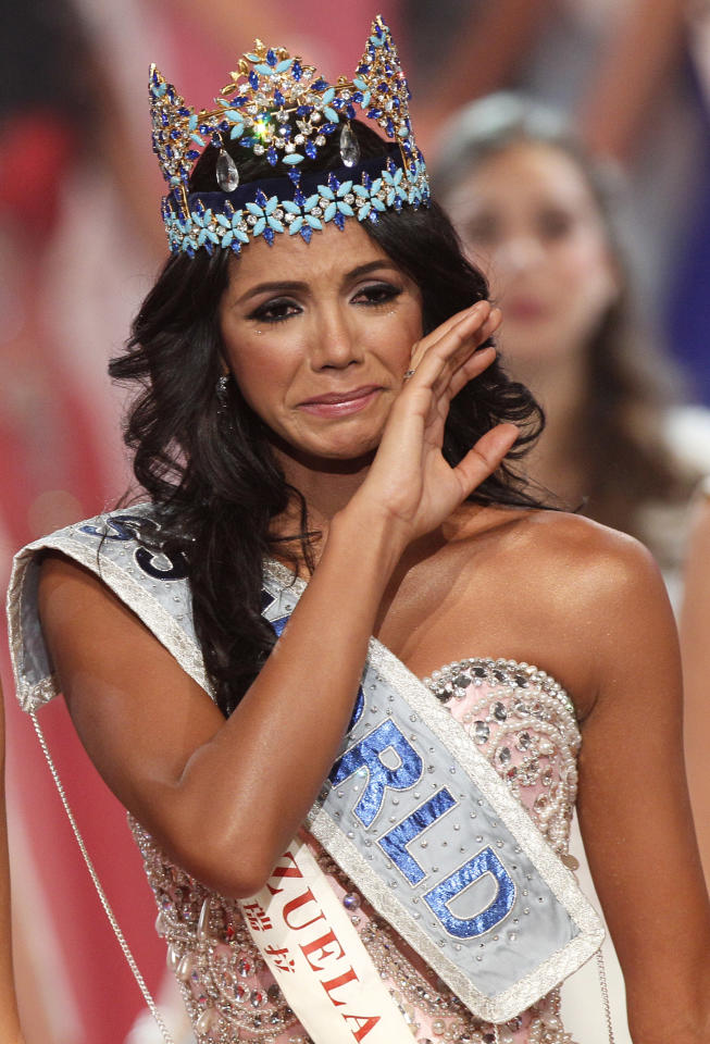Miss Venezuala Ivian Sarcos reacts as she is crowned winner at the Miss World competition held at Earls Court in London, Sunday, Nov. 6, 2011. (AP Photo/Kirsty Wigglesworth)