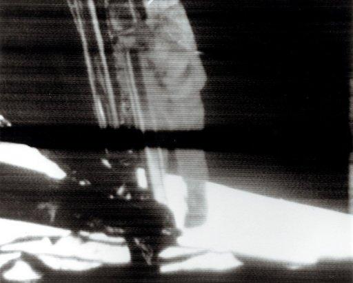 "A TV camera records Apollo 11 astronaut Neil Armstrong as he climbs down the ladder from the lunar module ""Eagle"" on July 21, 1969, becoming the first man to set foot on the moon. Armstrong, has died following complications from cardiovascular surgery. He was 82"