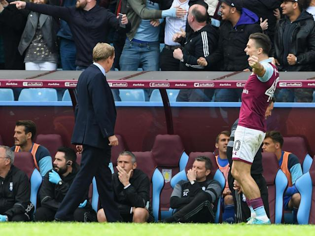 Jack Grealish celebrates right in front of the Birmingham dugout