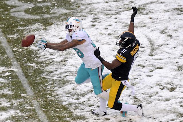 Miami Dolphins cornerback Nolan Carroll (28) cannot come up with the interception of a pass intended for Pittsburgh Steelers wide receiver Markus Wheaton (11) during the second half of an NFL football game in Pittsburgh, Sunday, Dec. 8, 2013. (AP Photo/Don Wright)