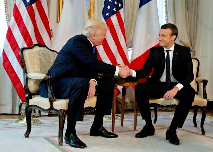 President Trump shakes hands with French President Emmanuel Macron before a working lunch before a NATO summit in Brussels May 25. (Peter Dejong/Pool via Reuters)