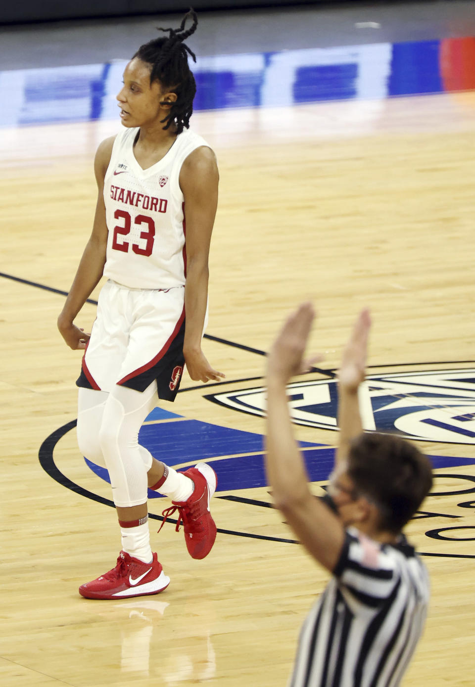 Stanford guard Kiana Williams (23) reacts after sinking a three-point basket during the first half of an NCAA college basketball game against Oregon State in the semifinal round of the Pac-12 women's tournament Friday, March 5, 2021, in Las Vegas. (AP Photo/Isaac Brekken)