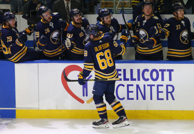 Buffalo Sabres forward Victor Olofsson (68) celebrates his goal with teammates during the first period of an NHL hockey game against the Montreal Canadiens, Wednesday, Oct. 9, 2019, in Buffalo N.Y. (AP Photo/Jeffrey T. Barnes)