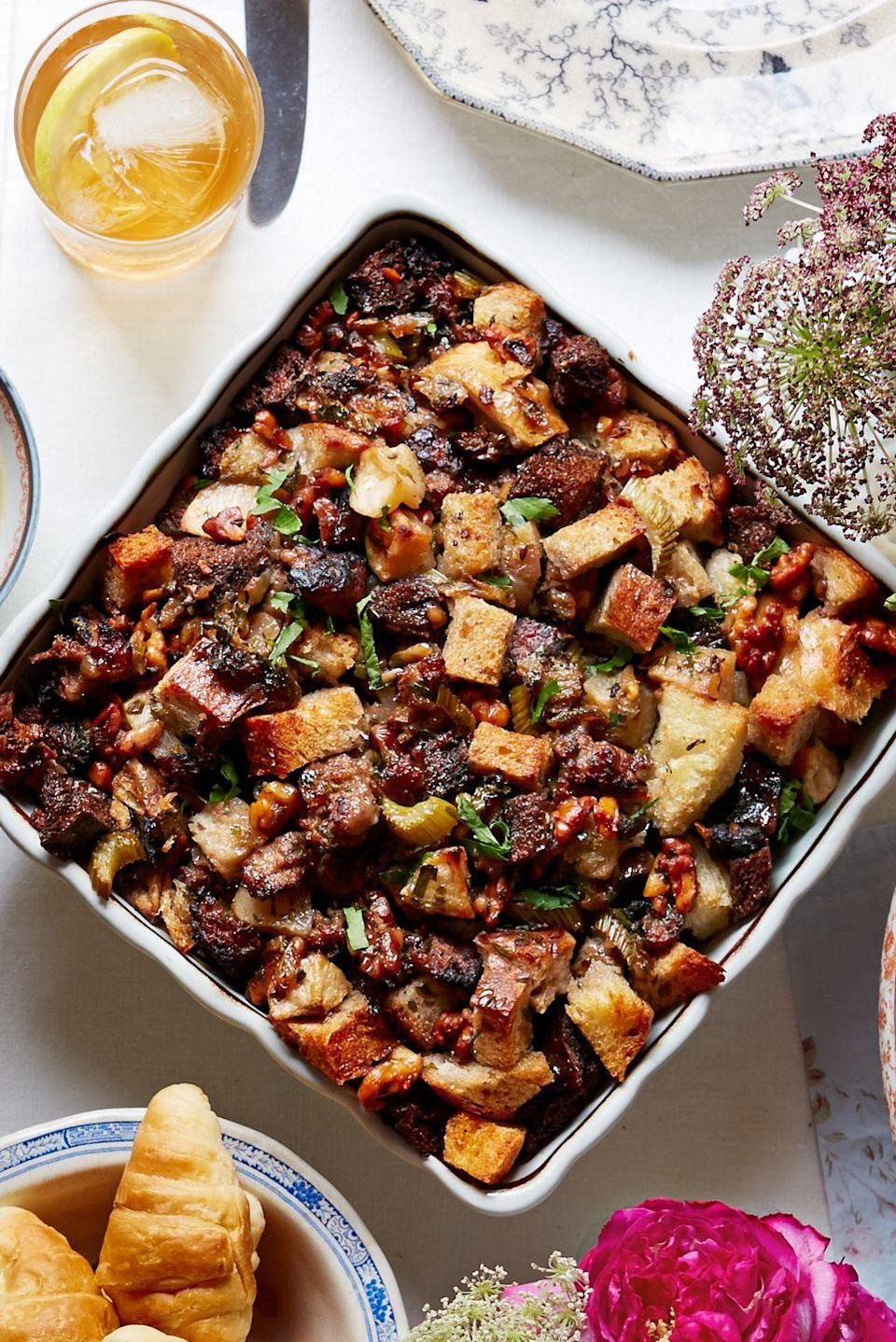 """<p>To make this stuffing really sing, use a few different kinds of artisanal bread and the best ground sausage you can find. You <em>could</em> halve the recipe, but stuffing makes great leftovers. </p><p><strong><a href=""""https://www.countryliving.com/food-drinks/recipes/a5271/apple-walnut-stuffing-recipe-clx1114/"""" rel=""""nofollow noopener"""" target=""""_blank"""" data-ylk=""""slk:Get the recipe"""" class=""""link rapid-noclick-resp"""">Get the recipe</a>.</strong></p><p><strong><a class=""""link rapid-noclick-resp"""" href=""""https://www.amazon.com/Victoria-Skillet-Seasoned-Flaxseed-Certified/dp/B01726HD72/?tag=syn-yahoo-20&ascsubtag=%5Bartid%7C10050.g.34645538%5Bsrc%7Cyahoo-us"""" rel=""""nofollow noopener"""" target=""""_blank"""" data-ylk=""""slk:SHOP SKILLETS"""">SHOP SKILLETS</a><br></strong></p>"""