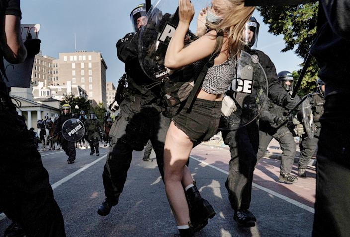Riot police rush demonstrators as they clear Lafayette Park and the area around it across from the White House for President Donald Trump to be able to walk through for a photo opportunity in front of St. John's Episcopal Church, during a rally against the death in Minneapolis police custody of George Floyd, near the White House, in Washington, U.S. June 1, 2020. (Ken Cedeno/Reuters)