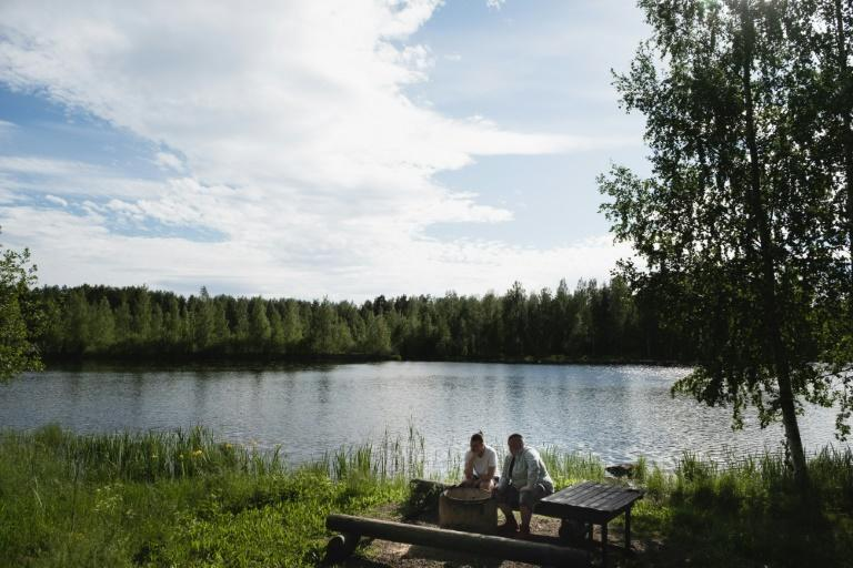 Friends Leevi Natunen (L) and Miika Leikas say they just don't fancy moving away from where they grew up (AFP/Alessandro RAMPAZZO)