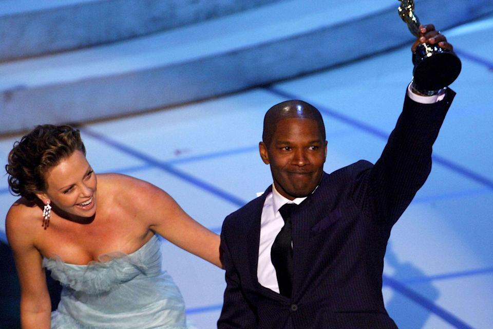 "<p> Jamie Foxx held his trophy high after Charlize Theron announced his name as Best Actor for playing Ray Charles in<em> <a href=""https://www.amazon.com/dp/B001NMLMAQ?ref=sr_1_1_acs_kn_imdb_pa_dp&qid=1547580417&sr=1-1-acs&autoplay=0&tag=syn-yahoo-20&ascsubtag=%5Bartid%7C10055.g.5132%5Bsrc%7Cyahoo-us"" rel=""nofollow noopener"" target=""_blank"" data-ylk=""slk:Ray"" class=""link rapid-noclick-resp"">Ray</a></em>.</p>"