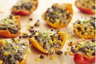 "<p>Venture south of the border for dinner with these 20-minute stuffed peppers.</p><p>Get the recipe from <a href=""https://www.delish.com/cooking/recipe-ideas/recipes/a43193/stuffed-peppers-corn-black-beans-pepperjack-recipe/"" rel=""nofollow noopener"" target=""_blank"" data-ylk=""slk:Delish"" class=""link rapid-noclick-resp"">Delish</a>.<br></p>"