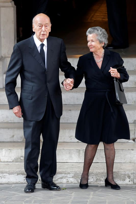 FILE PHOTO: Former French President Valery Giscard d'Estaing and his wife Anemone leave after the funeral ceremony for French businesswoman and billionaire Liliane Bettencourt in Neuilly-sur-Seine near Paris