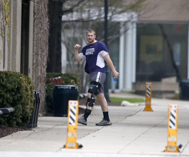 Northwestern football player Shane Mertz walks into McGaw Hall, where voting is taking place on whether to form the nation's first union for college athletes, Friday, April 25, 2014, in Evanston, Ill. (AP Photo/Charles Rex Arbogast)