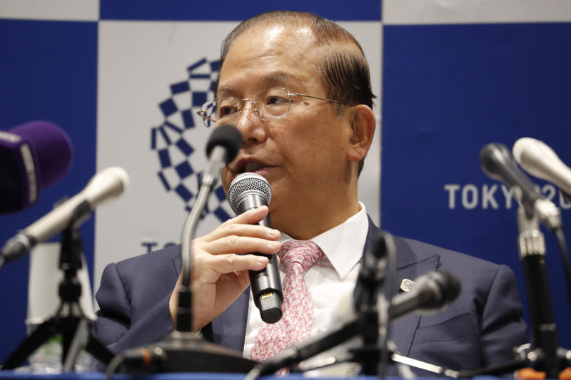 """Tokyo 2020 Organizing Committee CEO Toshiro Muto speaks during a news conference after a Tokyo 2020 Executive Board Meeting in Tokyo Monday, March 30, 2020. Tokyo Olympic President Yoshiro Mori said Monday he expects to talk with IOC President Thomas Bach this week about potential dates and other details for the rescheduled games next year. Both Mori and Muto said the the cost of rescheduling will be """"massive"""" - local reports suggest several billion dollars - with most of the expenses borne by Japanese taxpayers. (Issei Kato/Pool Photo via AP)"""